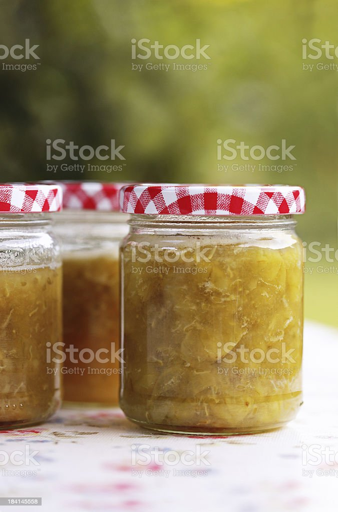 Home Made Jam Cooling on Garden Table stock photo