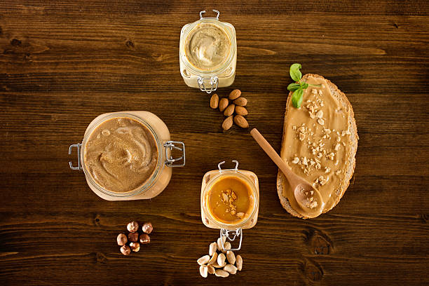 Home made peanut butter and other kinds of nut butters stock photo