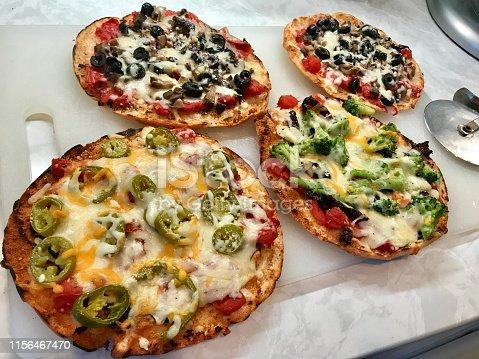 Four home made pizzas.