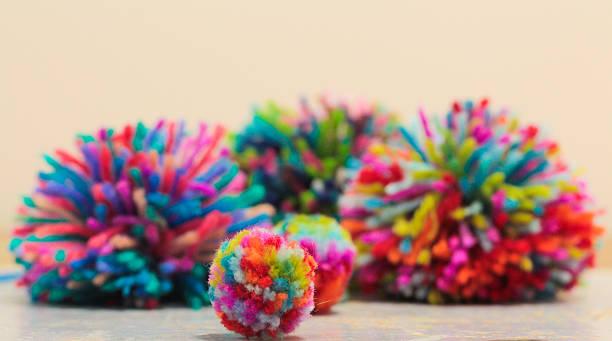 home made pom-poms! - pompon stockfoto's en -beelden
