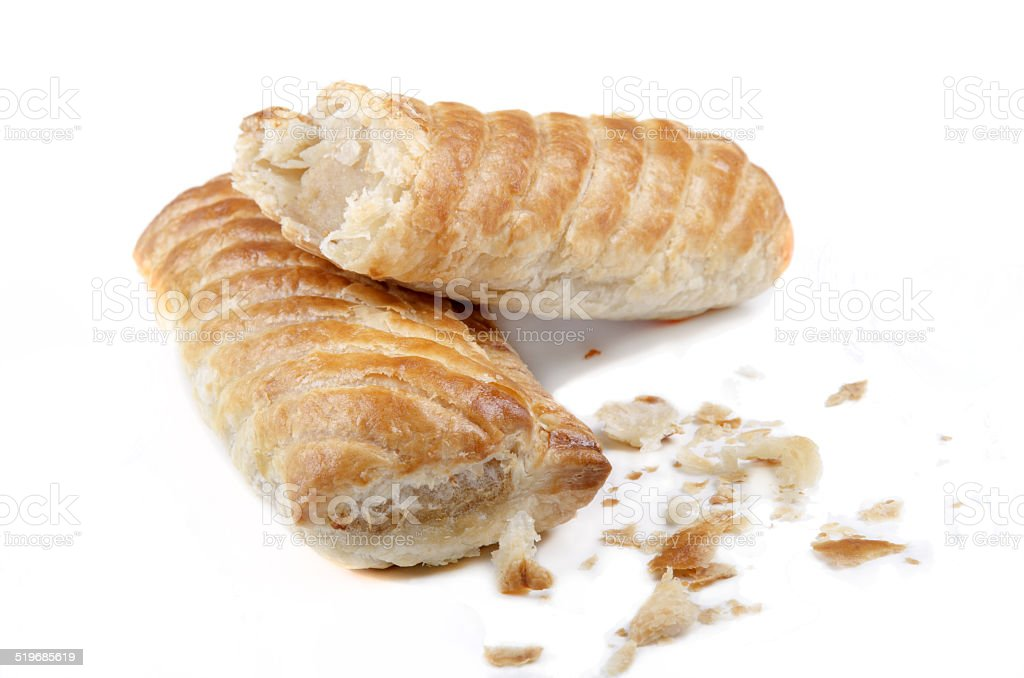 home made sausage rolls on bright background stock photo