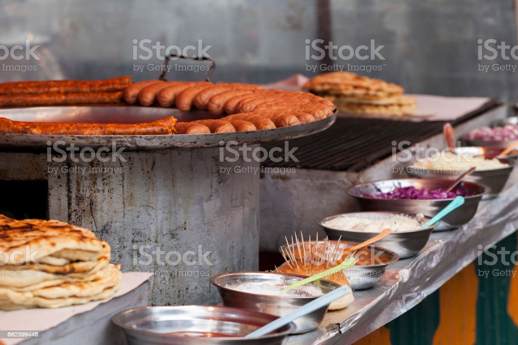 Home made smoked sausage that is fried in fat royalty-free stock photo