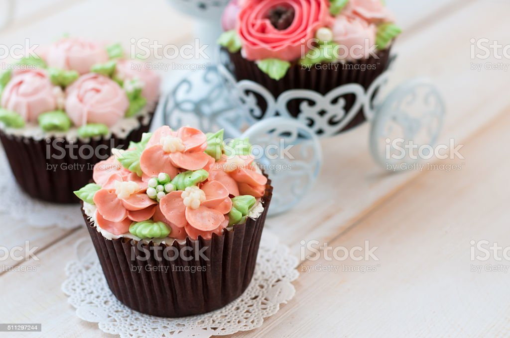 Home Made Sponge Cupcakes With Flowers Buttercream Royalty Free Stock Photo