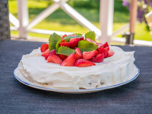 Home made strawberry cake with whipped cream. Typical Swedish dessert in midsummer. stock photo