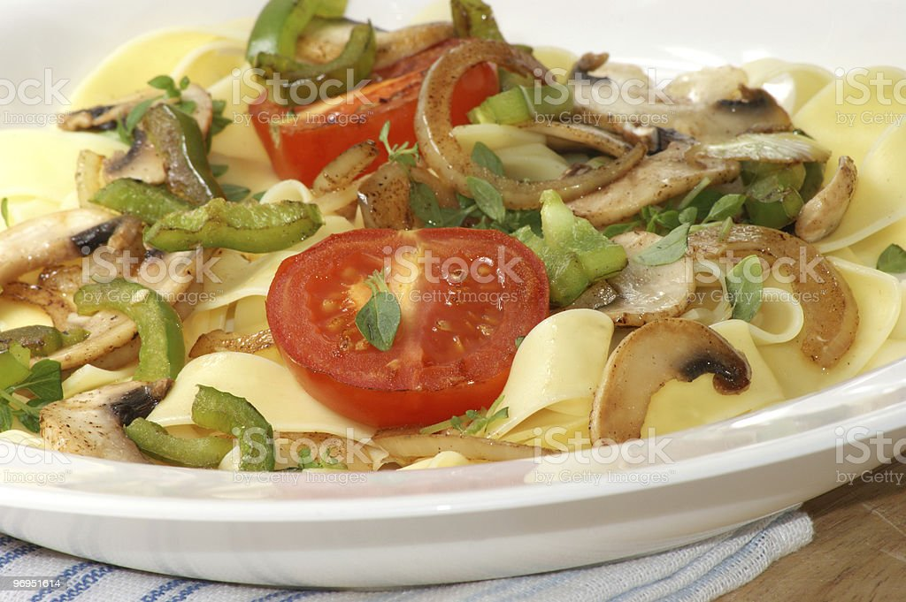 home made tagliatelle with organic tomato and mushroom royalty-free stock photo