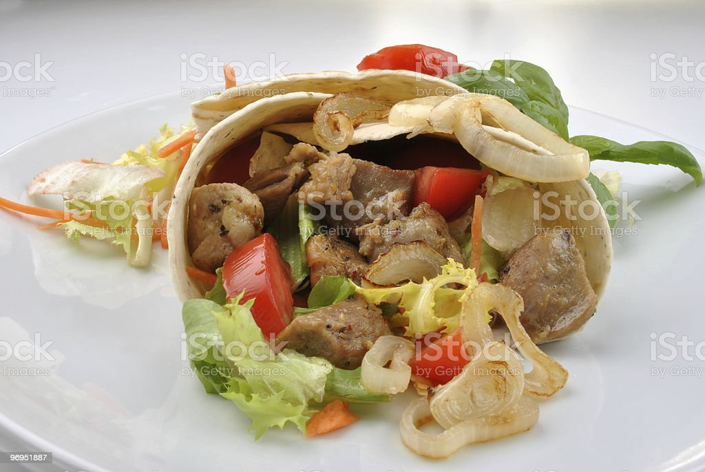 home made tortillia with organic pork goulash royalty-free stock photo