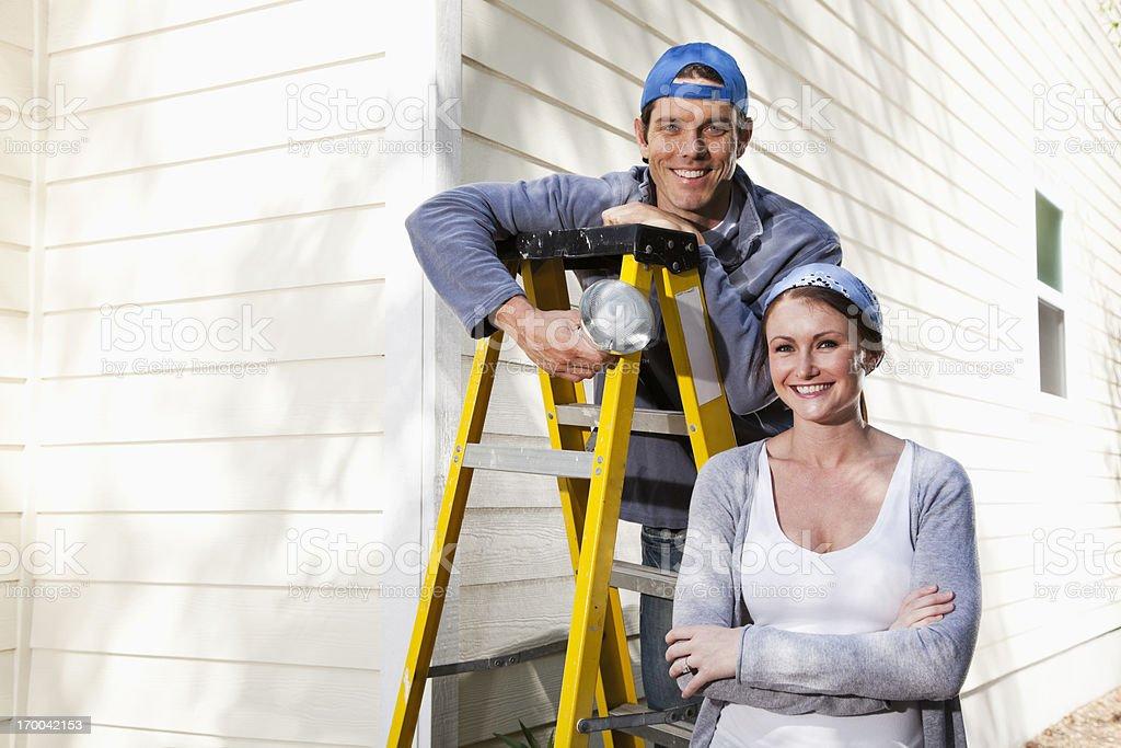 Home maintenance, changing lightbulb stock photo