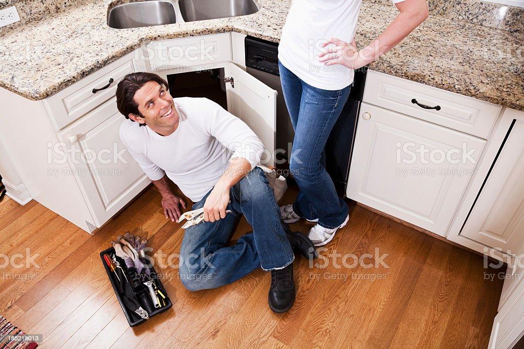Home maintenance, fixing kitchen sink stock photo