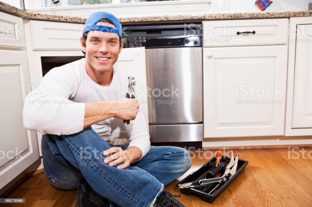 Home maintenance, under kitchen sink stock photo