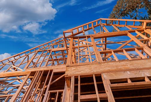Home new wood frame stick built home under construction a blue sky