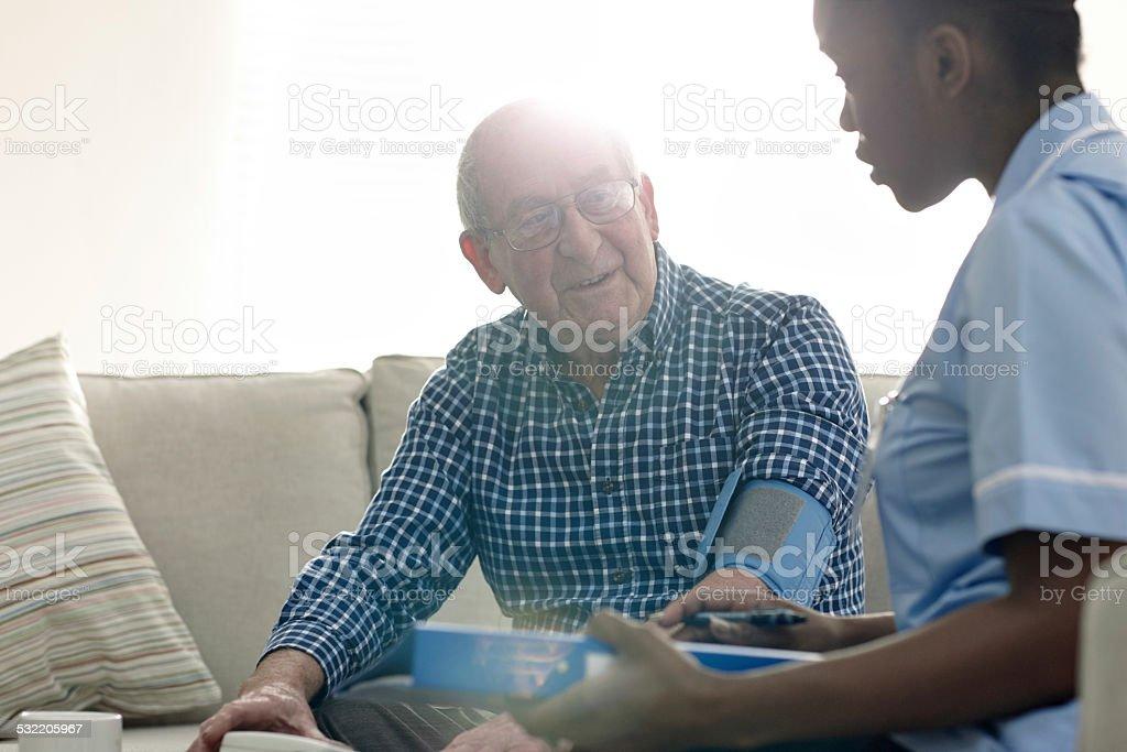 Home nurse with senior patients stock photo