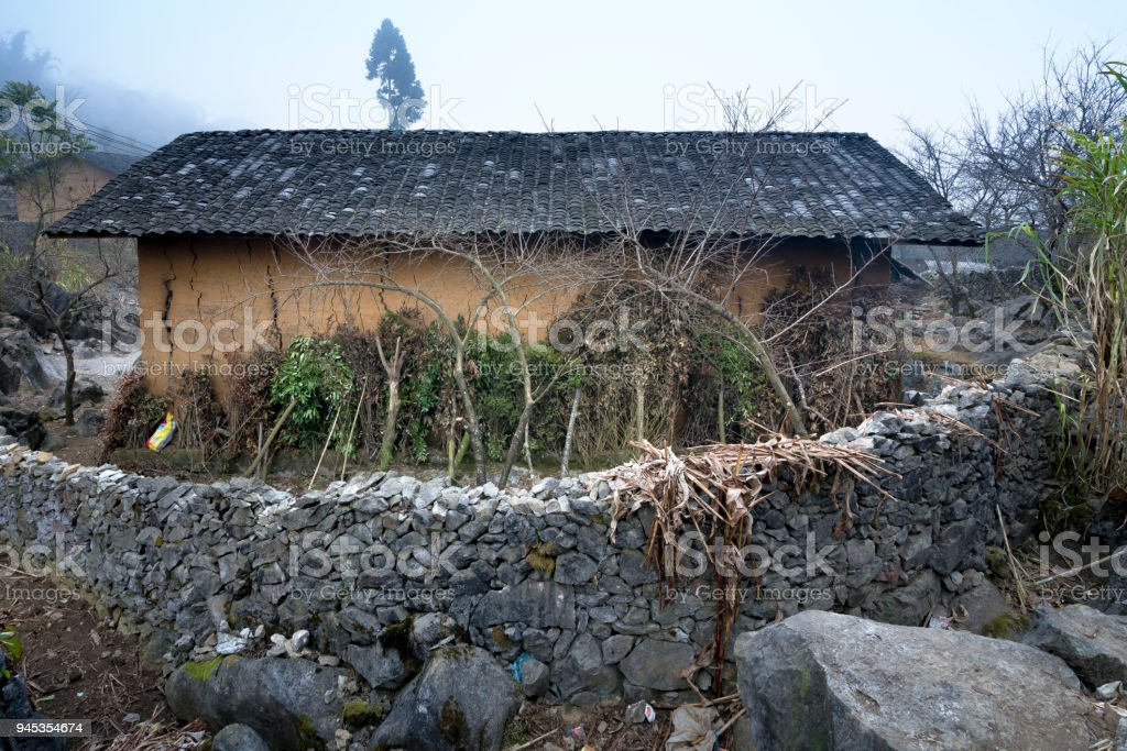 A home of the H'mong minority with fences made of stone in Ha Giang province, Viet Nam stock photo
