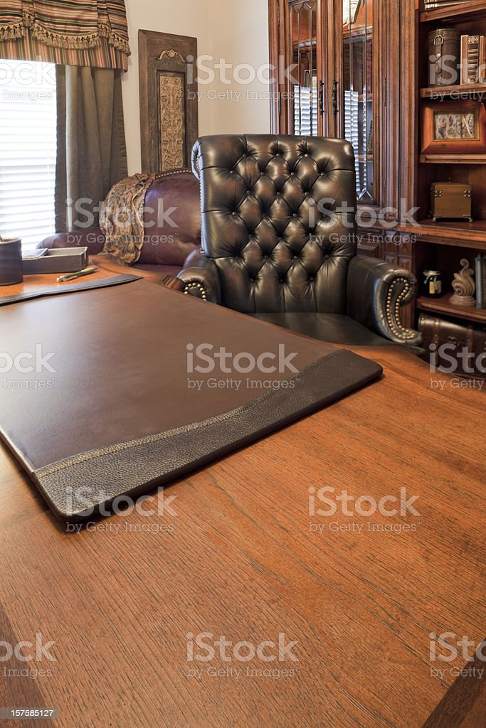 home office desk with chair and bookcase stock photo