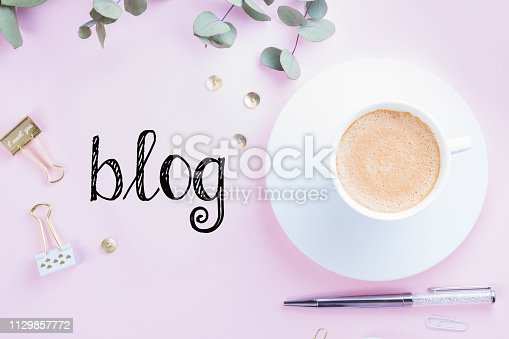 509867718istockphoto Home office desk with phone 1129857772