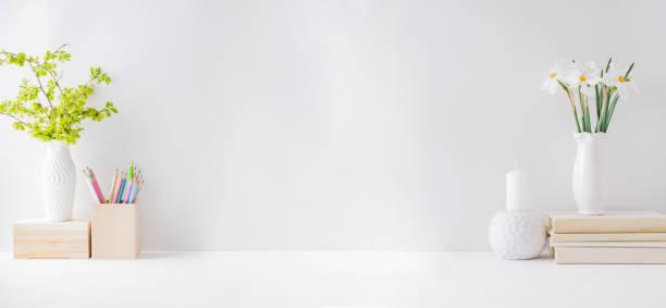 Home office interior for bloggers workplace with white daffodils in a picture id1205087749?b=1&k=6&m=1205087749&s=612x612&w=0&h=gditr4ridsd d1v8rnr0fbi8jbpomjbf1zgcqq9fpcq=