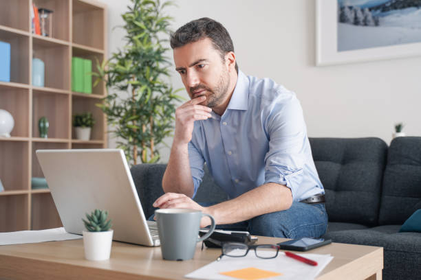 Home office, man working from home portrait stock photo