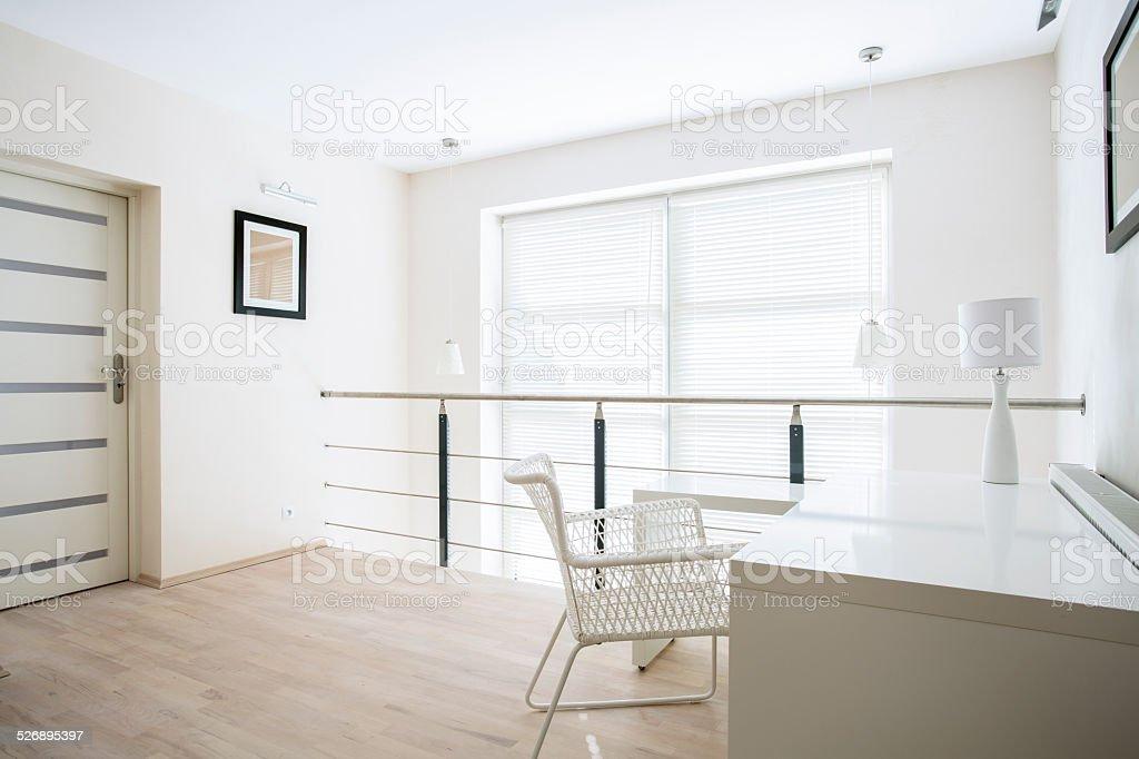 Home office on mezzanine floor stock photo