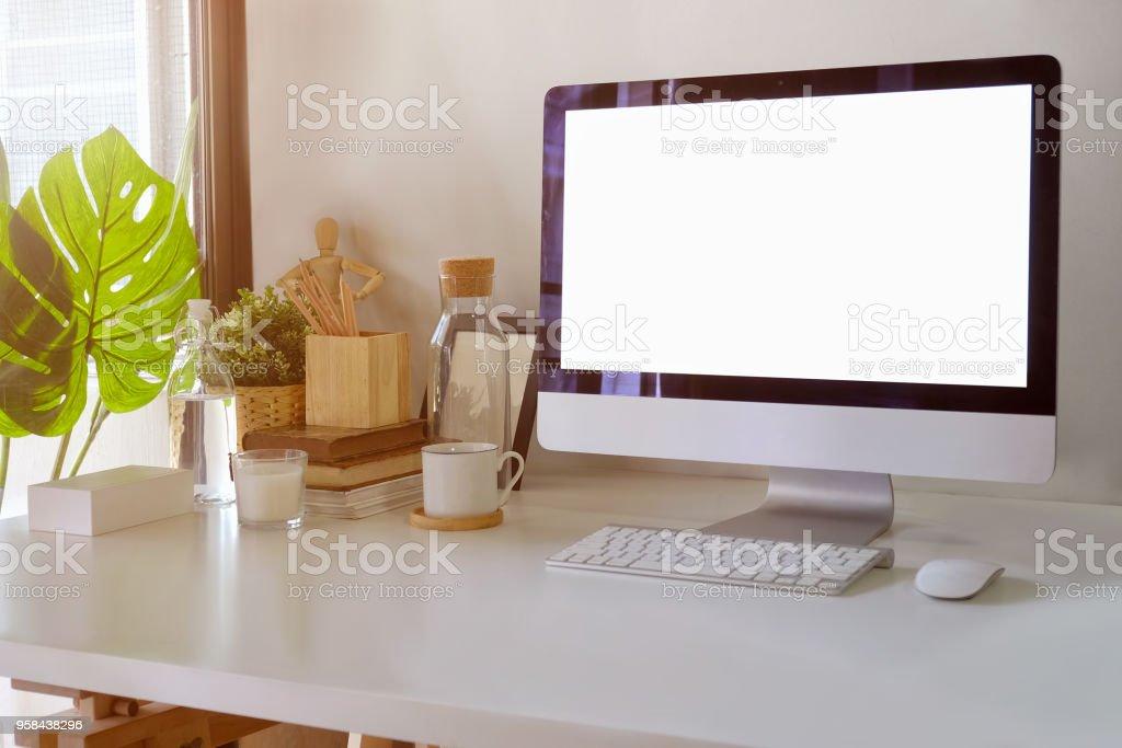 Home office workspace desktop computer showing blank screen on desk. stock photo