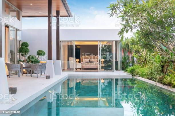 Photo of home or house building Exterior and interior design showing tropical pool villa with green garden and bedroom