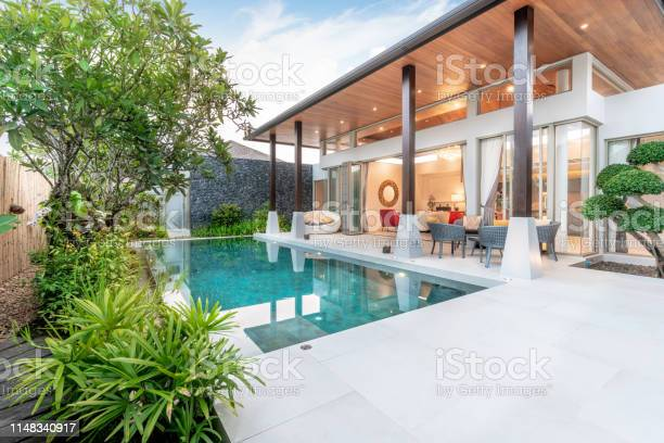 Photo of home or house Exterior design showing tropical pool villa with greenery garden,