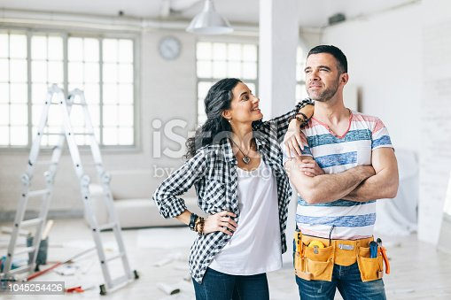 Home owners in their new apartment