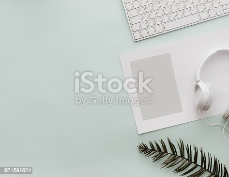 istock Home Pastel Office Desktop with keyboard, empty blank and headphones
