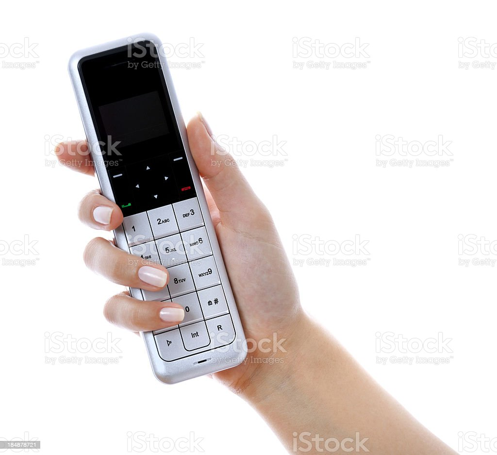 home phone in woman hand on white royalty-free stock photo