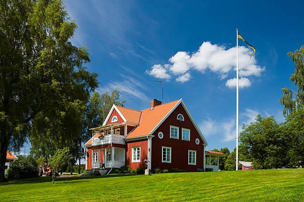 Home. Farm House in Sweden. Swedish flag on a flagpole. Home sweet home. russian dacha stock pictures, royalty-free photos & images