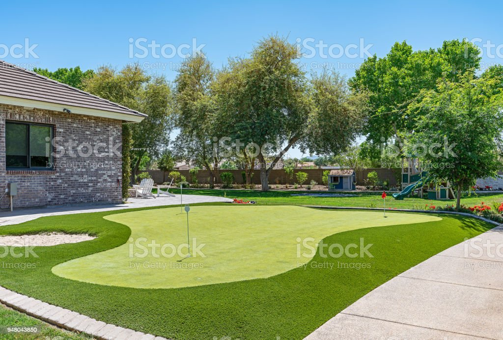 Home Putting Green Photo of a modern home putting green. Flower Stock Photo