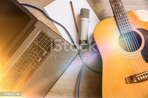 istock Home recording equipment for music laptop guitar and microphone 1249237762