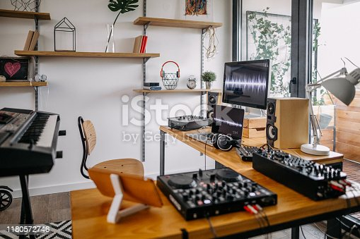 Interior of home recording studio with dj sound mixing equipment