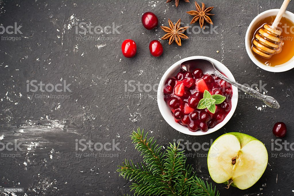 Home Relish sauce of apples and cranberries for submission to stock photo