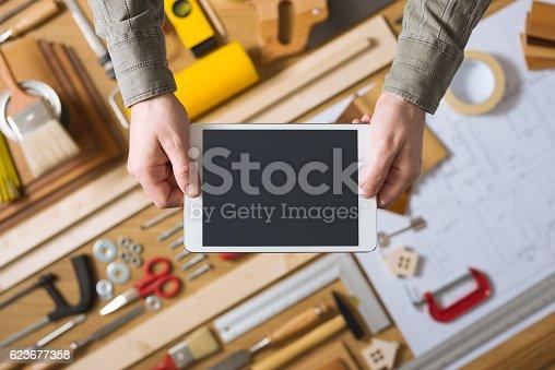 1134879628 istock photo Home renovation and diy mobile app 623677358