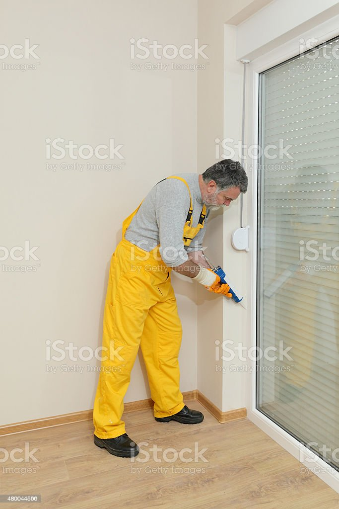 Home renovation, caulking with silicone stock photo