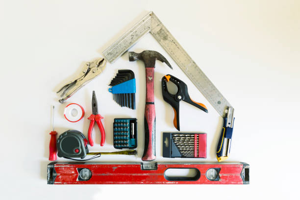Home renovation concept. Shape of a house from construction tools. Home renovation concept. Shape of a house from construction tools. home improvement stock pictures, royalty-free photos & images