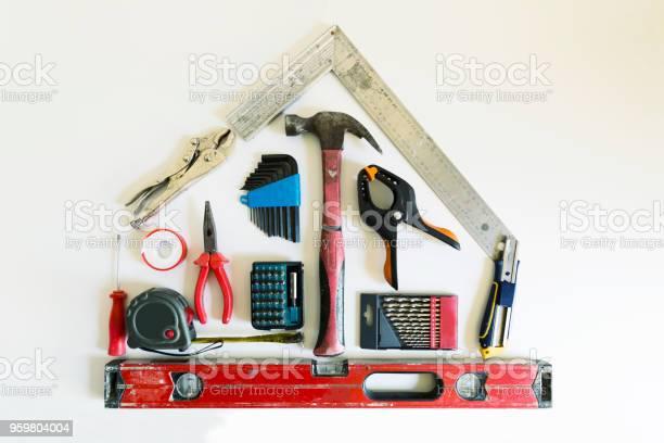 Home Renovatie Concept Vorm Van Een Huis Van De Hulpmiddelen Van De Bouw Stockfoto en meer beelden van Apparatuur