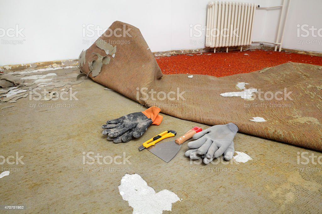 Home renovation, old carpet remove stock photo