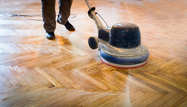 Home renovation, parquet sanding, polishing stock photo
