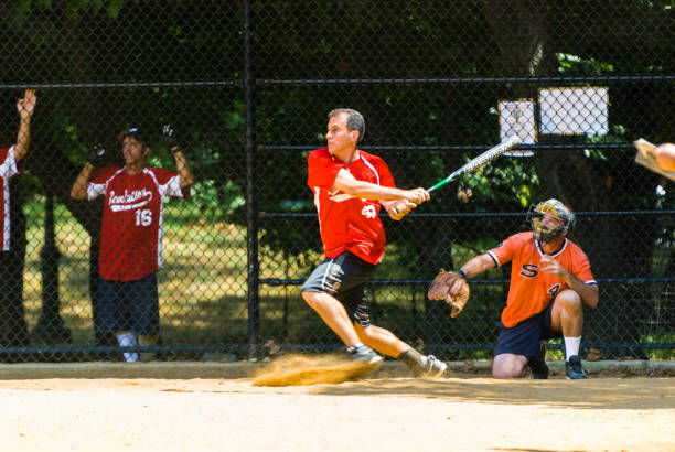 home run - softball stock photos and pictures