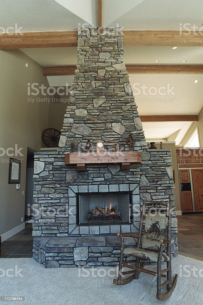 Home rustic fireplace royalty-free stock photo