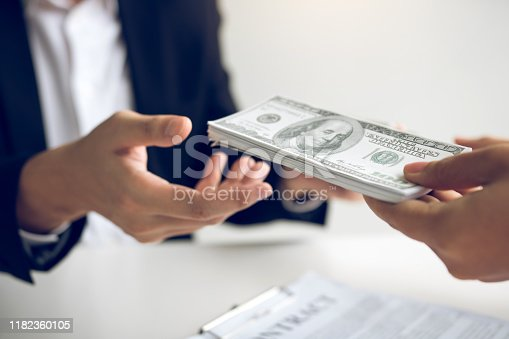 481337750istockphoto Home sales brokers and real estate investors are exchanging with investors being filing cash at the agent's hand. 1182360105