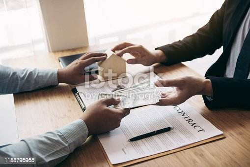 481337750 istock photo Home sales brokers and real estate investors are exchanging with investors being filing cash at the agent's hand. 1188795955
