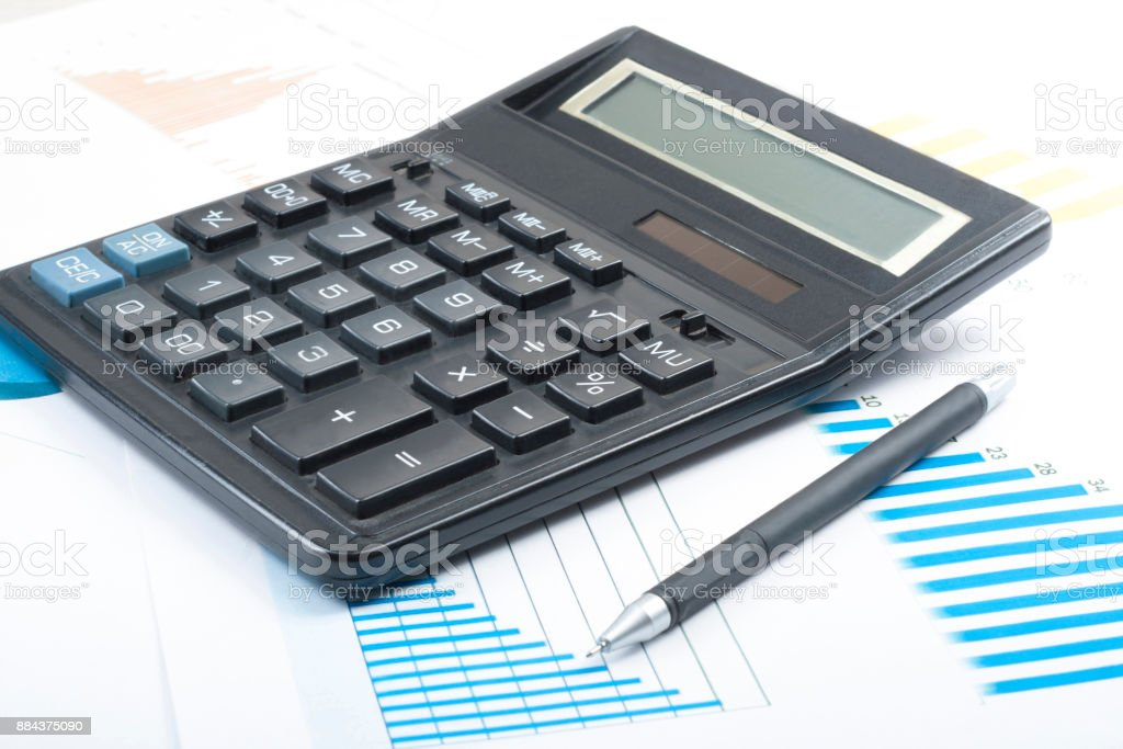 home savings budget concept calculator pen and chart on office table