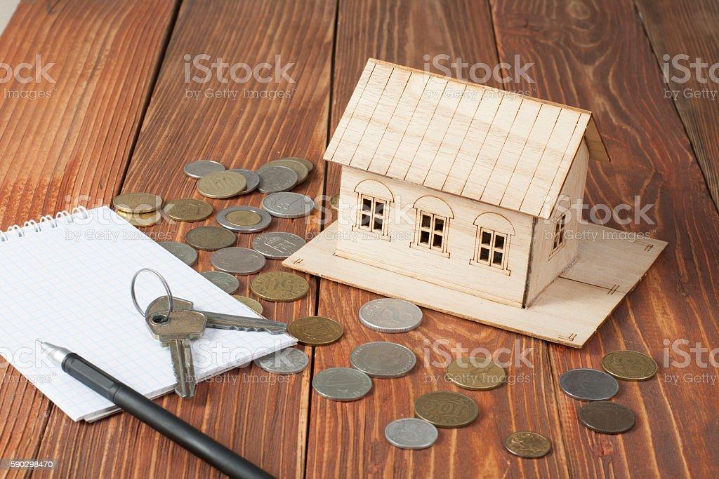 Home savings, budget concept. Model house, notepad, pen, calculator and royaltyfri bildbanksbilder
