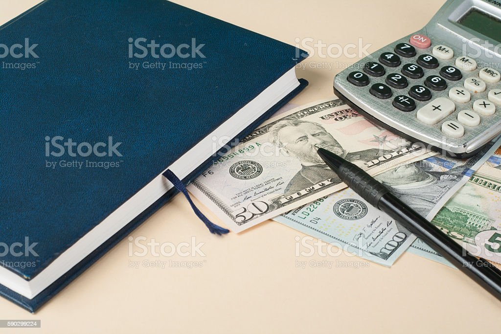 Home savings, budget concept. Model house, notepad, pen, calculator and royaltyfri bildbanksbilder