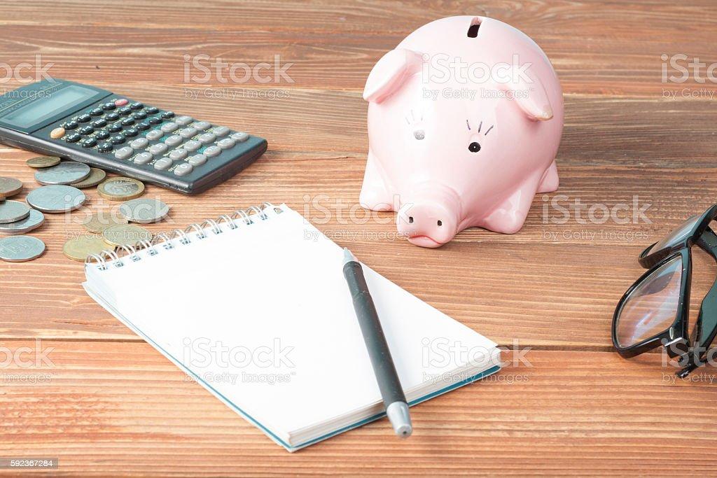 Home savings, budget concept. Model house, notepade, pen, calculator...