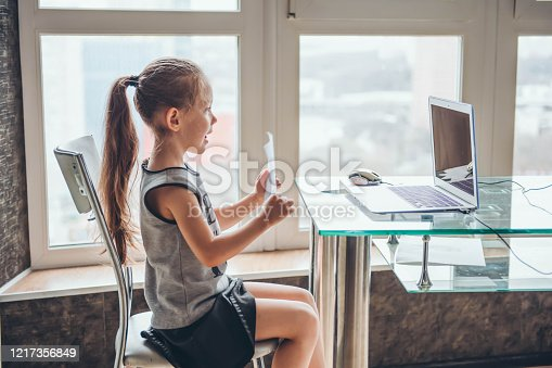 School girl  is studying online. Home schooling. Distance education.