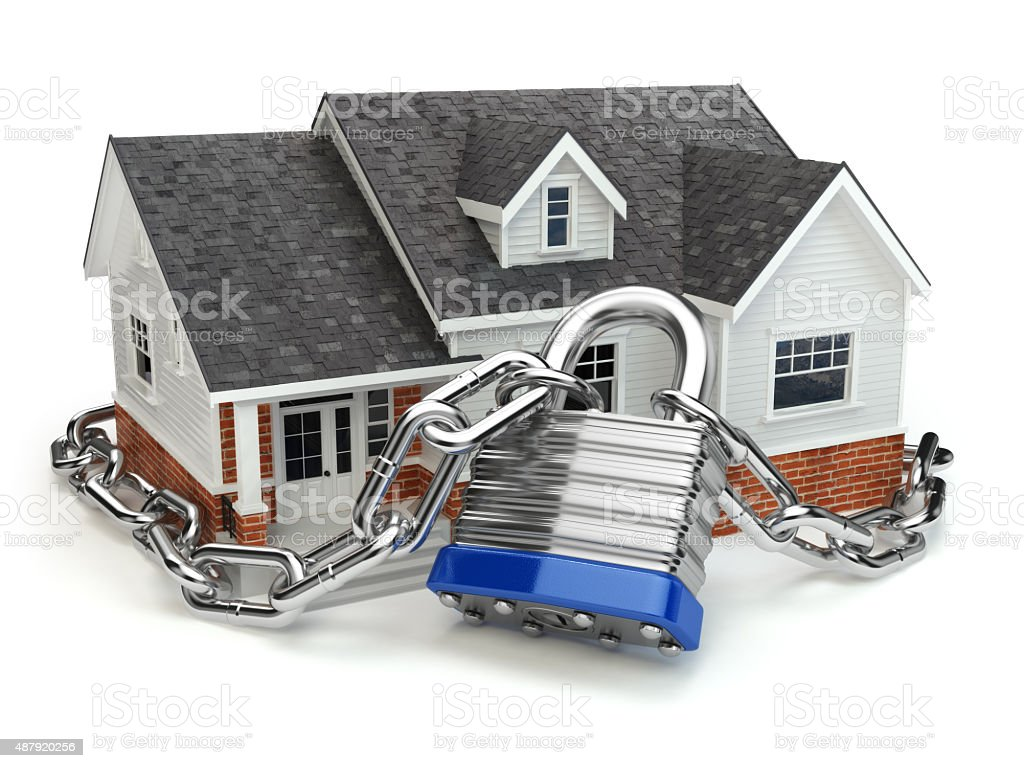 Home security concept. House with lock and chain stock photo