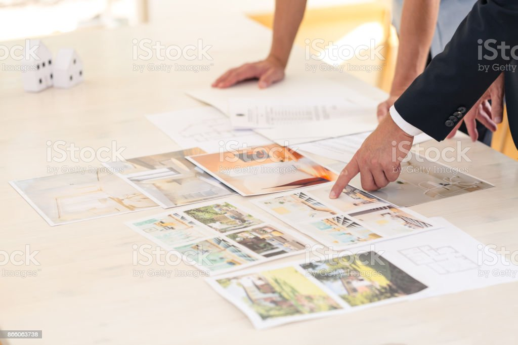 Home seller presenting property advantages stock photo