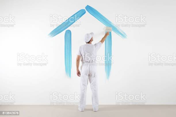 Home service concept painter man with brush drawing a blue house on picture id813842676?b=1&k=6&m=813842676&s=612x612&h=vjqcamgvqpijx jabh5ahpgbvmr kp862fwepggfpws=